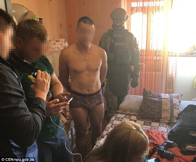4E2F94D600000578-5949917-Police_have_arrested_a_man_pictured_centre_for_raping_his_eight_-a-15_1531476091100